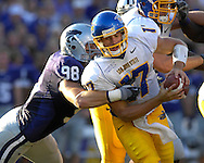 MANHATTAN, KS - SEPTEMBER 08:  Linebacker Ian Campbell (98) of the Kansas State Wildcats tackles quarterback Adam Tafralis (17) of the San Jose State Spartans during a NCAA football game at Bill Snyder Family Stadium in Manhattan, Kansas.  (Photo by Peter Aiken/Getty Images)