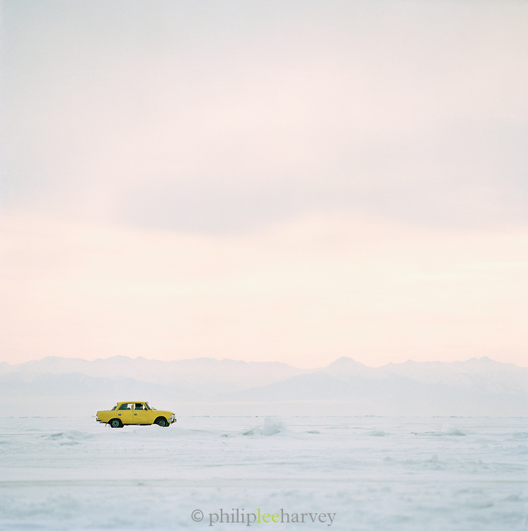 A car driving over the frozen Lake Baikal in Siberia, Russia