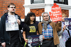 © Licensed to London News Pictures. 20/05/2019. London, UK.  Julian Assange supporters protest outside the Ecuadorian embassy in London today. WikiLeaks have reported that Julian Assange's belongings from his time living in the Ecuadorian embassy in London will be handed over to US prosecutors today. Photo credit: Vickie Flores/LNP