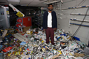 After the riots of London and other UK cities, Sri Lankan-born Sivaharan (Siva) Kandiah expresses shock in his looted shop 'Clarence Convenience Store' in Clarence Road, Hackney. After the riots of London and other UK cities, Sri Lankan-born Sivaharan (Siva) Kandiah expresses shock in his looted shop 'Clarence Convenience Store' in Clarence Road, Hackney. During the riot in London on Monday 8th August, local youths and older residents of nearby estates ransacked the business and either removed Siva's stock or left the rest to spoil on the unrefrigerated floor. In alcohol and cigarettes alone, he lost £50,000 in stock but during the campaign top help him recover, more than £16,000 was raised by his customers and friends.