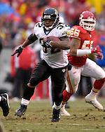Jacksonville Jaguars running back Maurice Jones-Drew (32) rushes up field past Kansas City Chiefs linebacker Derrick Johnson (56) in the second quarter at Arrowhead Stadium in Kansas City, Missouri, December 31, 2006.  The Chiefs lead the Jaguars at halftime 21-10.<br />