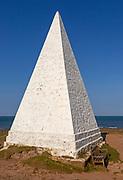 Emmanuel Head white pyramidal navigation beacon, Holy Island, Northumberland, England, UK built 1801-10 by Trinity House