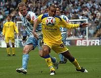 Photo: Ian Hebden.<br /> Coventry City v Cardiff City. Coca Cola Championship. 30/04/2006.Coventrys Gary McSheffrey (L) tackles Cardiffs Kurtis McDonald (R).