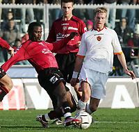 "Samuel Kuffour (Livorno), Christian Wilhelmsson (Roma)<br /> Italian ""Serie A"" 2006-07<br /> 21 Jan 2007 (Match Day 20)<br /> Livorno-Roma (1-1)<br /> ""Armando Picchi"" Stadium-Livorno-Italy<br /> Photographer Luca Pagliaricci INSIDE"
