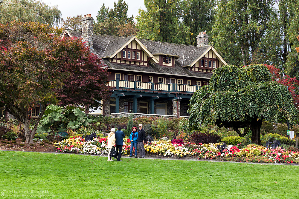 Visitors to Deer Lake pose for photos in the Century Gardens at Ceperly House. Ceperley House was constructed in 1911 and has been home to the Burnaby Art Gallery since the late 1960's.  The mansion is surrounded by the Century Gardens within the northern border of Deer Lake Park in Burnaby, British Columbia, Canada.