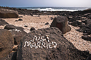 'Just Married' spelled out in white stones at South Point on the Big Island of Hawaii.