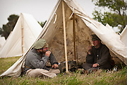 Confederate re-enactors rest in camp at Fort Moultrie Charleston, SC. The re-enactors are part of the 150th commemoration of the US Civil War.