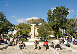 Washington DC; USA: Dupont Circle area, noted for its fountain, street musicians, bookstores, shops, embassies, and brick houses.  The fountain at Dupont Circle..Photo copyright Lee Foster Photo # 21-washdc75390