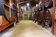 Chateau de Nouvelles. Fitou. Languedoc. Barrel cellar. Wooden fermentation and storage tanks. France. Europe.