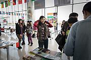 Students and visitors participate in a semester-end international fair at the Duke Kunshan University in Kunshan, Jiangsu Province , China on 07 December, 2014.