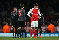 Arsenal's Alex Oxlade-Chamberlain looks dejected after his side concede a 5th goal during the UEFA Champions League Round of 16, Second Leg match at the Emirates Stadium, London.