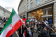Activists call for 'No War On Iran' at a demonstration and march organised by the Stop The War Coalition and Campaign for Nuclear Disarmament (CND) in London. Tensions between the US and Iran soared to their highest point since the 1979 hostage crisis this past week following the killing of Iranian military commander Qassem Suleimani by an American drone strike in Baghdad on January 3. Suleimani, leader of the overseas-operating Quds Force division of Iran's Islamic Revolutionary Guard Corps (IRGC), was one of the chief architects of Iran's regional military policy for more than two decades. Though the sense of immediate crisis has since abated, a senior IRGC commander, Abdollah Araghi, declared on Thursday in comments reported by the New York Times that 'harsher revenge' than Wednesday's barrage of largely symbolic reprisal strikes against two military bases in Iraq was coming 'in the near future'. Saturday, Jan 11, 2020. (Photo/Vudi Xhymshiti)