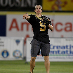 Apr 28, 2010; Metairie, LA, USA; Drew Brees (9) throws the ball during the Heath Evans Foundation charity softball game featuring teammates of the Super Bowl XLIV Champion New Orleans Saints at Zephyrs Field.  Mandatory Credit: Derick E. Hingle-US-PRESSWIRE.