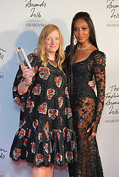 Sarah Burton collects the British Brand Award for Alexandrer McQueen alongside Naomi Campbell in the press room during The Fashion Awards 2016 at the Royal Albert Hall, London.