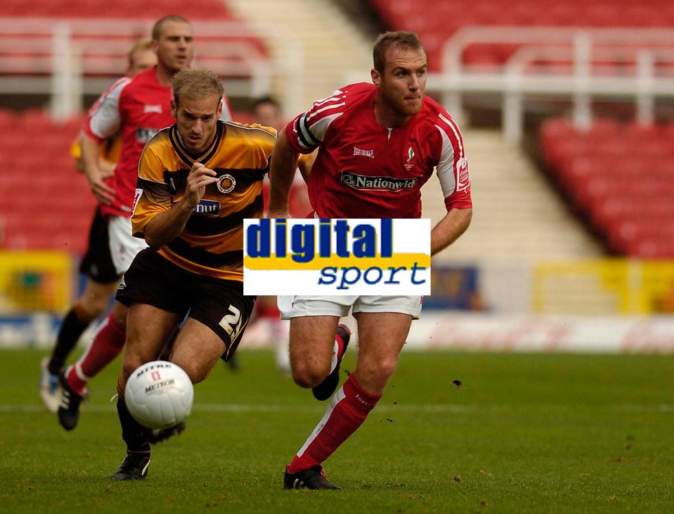 Photo: Alan Crowhurst.<br />Swindon Town v Boston Utd. The FA Cup. 05/11/2005.<br />Sean O'Hanlon (R) of Swindon takes on Lawrie Dudfield.