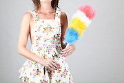 Housewife cleaning the house with feather duster. Model released