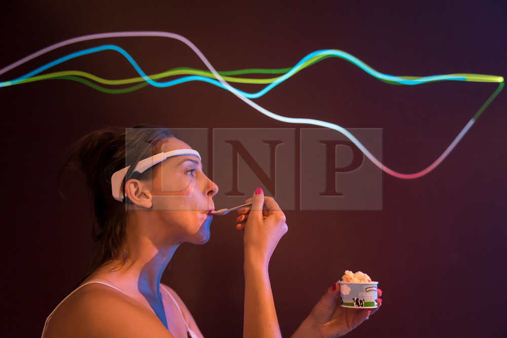 """© Licensed to London News Pictures. 03/07/2018. LONDON, UK. The brain waves of a staff member experiencing eating ice cream are seen at a preview of """"SCOOP: A Wonderful Ice Cream World"""", the first official exhibition of the British Museum of Food.  The exhibition presents items from the Robin and Caroline Weir Collection and explores the science and appeal of ice cream going back 400 years.  The exhibition takes place at the Gasholders near Granary Square in Kings Cross and runs 3 July to 30 September 2018.  Photo credit: Stephen Chung/LNP"""