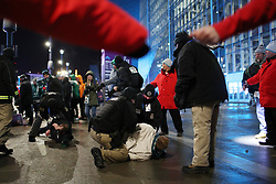 February 4, 2018 - Minneapolis, MN, USA - Police detain two men after another was knocked unconscious during a fight as fans left U.S. Bank Stadium after Super Bowl LII on Sunday, Feb. 4, 2018 in Minneapolis, Minn. (Credit Image: © Anthony Souffle/TNS via ZUMA Wire)
