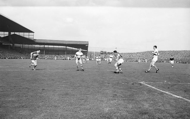 Two Kerry players close in on Derry who has possession of the ball during the All Ireland Minor Gaelic Football Final Kerry v. Derry in Croke Park on the 26th September 1965.