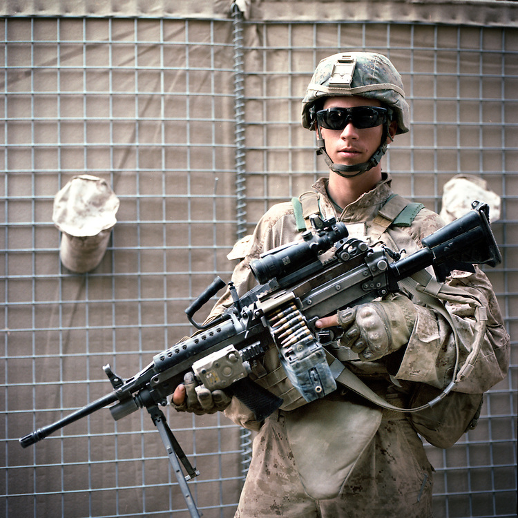 """Location:<br /> Patrol Base Fires, Sangin District, Helmand Province, Afghanistan<br /> <br /> Unit: <br /> 3rd Squad, 1st Platoon, Bravo Company, 1st Battalion, 5th Marines<br /> <br /> Name and Rank: Lance Corporal Taylor """"Gecko"""" Moody<br /> <br /> Age: 20<br /> <br /> Hometown: Watertown, New York<br /> <br /> Why did you join the Marine Corps?<br /> <br /> """"I joined the Marine Corps mainly because I didn't really think I had a choice. My grades weren't all that great and I wanted to join the military anyway, so I decided for the Corps.""""<br /> <br /> Describe Sangin for someone back home:<br /> <br /> """"When we first got here we were expecting sand, of course, like everyone expects sand in Afghanistan, and then we come here to the green zone. Like, we knew we were gonna come into something green, but we didn't understand how green it was gonna be. You know, the reeds now are twelve feet tall and there's bamboo that's even taller than that.""""<br /> <br /> What does rigorous patrolling do to your body?<br /> <br /> """"I didn't notice it at first, but, the other Marines in my squad noticed and in other squads noticed, I had lost a shit ton of weight, and you can see it yourself—I'm extremely skinny—and I just kept losing more and more weight. <br /> <br /> So from a food perspective all I could do was think of food, and that's still all I do. On patrol, we'll take a quick break every now and then, you know post security, and I'll just be sitting there thinking 'God I'm so fucking hungry.'""""<br /> <br /> What's it like to move through the terrain?<br /> <br /> """"Moving around is completely demoralizing sometimes, like, you won't even go through a canal sometimes and you'll just be drenched, and you'll know it's just your own juice . . . like I say, you're just drenched in your own juice, your own sweat.""""<br /> <br /> What do you think about the Taliban?<br /> <br /> """"Every now and then we'll hit one of them, but because they're so small and unnoticeable, you know, they ble"""