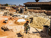 03 MARCH 2017 - BHAKTAPUR, NEPAL: A worker in the rebuilding of Bhaktapur's Durbur Square, the historic center of the city. Bhaktapur, a popular tourist destination and one of the most historic cities in Nepal was one of the hardest hit cities in the earthquake. Recovery seems to have barely begun nearly two years after the earthquake of 25 April 2015 that devastated Nepal. In some villages in the Kathmandu valley workers are working by hand to remove ruble and dig out destroyed buildings. About 9,000 people were killed and another 22,000 injured by the earthquake. The epicenter of the earthquake was east of the Gorka district.      PHOTO BY JACK KURTZ