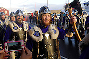 Tuesday 29th January 2013: Members of the Jarl Squad march towards the town centre during the Up Helly Aa 2013 festival in Lerwick, Shetland. Copyright 2013 Peter Horrell