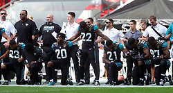 File photo dated 24-09-2017 of Jacksonville Jaguars players kneeling in protest during the national anthem before the NFL International Series match at Wembley Stadium, London.