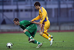 Danijel Marceta (18)  of Slovenia vs Costantin Gangioveanu of Romania  during Friendly match between U-21 National teams of Slovenia and Romania, on February 11, 2009, in Nova Gorica, Slovenia. (Photo by Vid Ponikvar / Sportida)