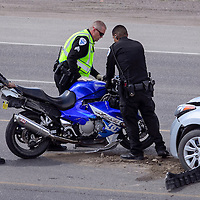 051614       Cable Hoover<br /> <br /> Gallup Police and New Mexico State Police wheel a crashed motorcycle into place to reconstruct the sequence of events at a crash on Historic Highway 66 in Gallup Friday.