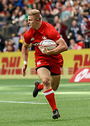 VANCOUVER, BC - MARCH 10: John Moonlight (#4) of Canada heads in to score during Game # 16- Usa vs Canada Pool A match at the Canada Sevens held March 10-11, 2018 in BC Place Stadium in Vancouver, BC. (Photo by Allan Hamilton/Icon Sportswire)