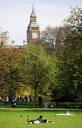 © Licensed to London News Pictures 24/04/2013.People relax during the warm weather and sunshine in St James Park, central London, with Big Ben in the background..London, UK.Photo credit: Anna Branthwaite/LNP