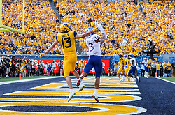 Oct 6, 2018; Morgantown, WV, USA; Kansas Jayhawks cornerback Hasan Defense (13) intercepts a pass in the end zone during the first quarter against the West Virginia Mountaineers at Mountaineer Field at Milan Puskar Stadium. Mandatory Credit: Ben Queen-USA TODAY Sports