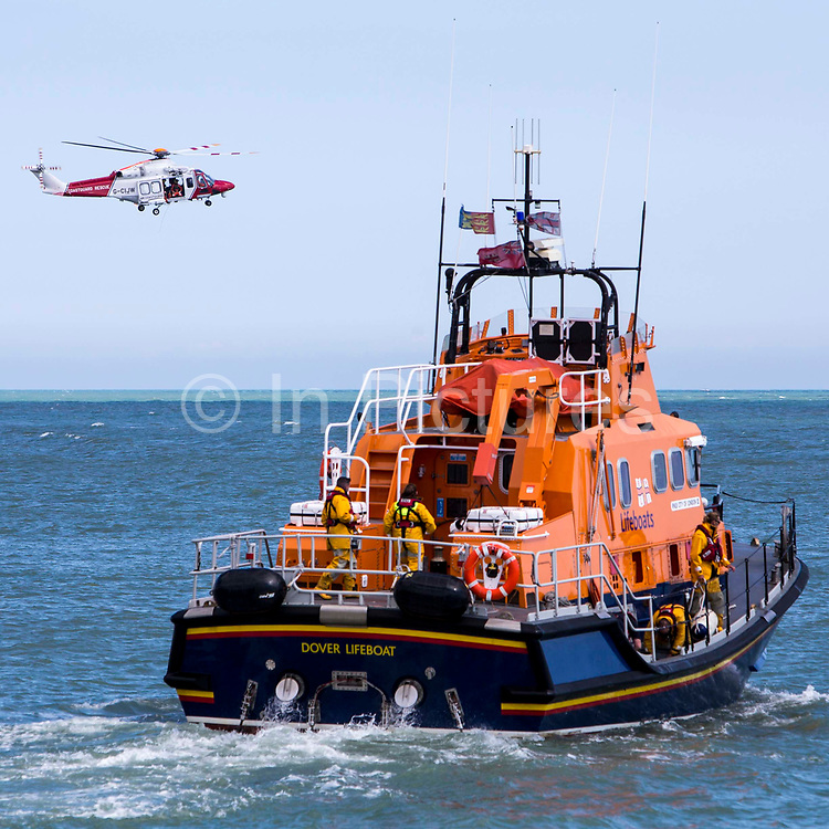 The Royal National Lifeboat Institution RNLI Dover Life boat 17-09,  HM Coastguard rescue helicopter G-C1JW take part in a joint training exercise in in the sea outside Folkestone Harbour, Folkestone, Kent. UK. 6th August 2016