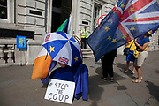 Anti Brexit protesters waving European Union flags and one with a stop the coup placard outside the Cabinet Office in Westminster as it is announced that Boris Johnson has had his request to suspend Parliament approved by the Queen on 28th August 2019 in London, England, United Kingdom. The announcement of a suspension of Parliament for approximately five weeks ahead of Brexit has enraged Remain supporters who suggest this is a sinister plan to stop the debate concerning a potential No Deal.