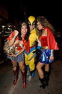 The Wolverine with two women dressed as Wonder Woman