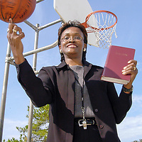 Nzinga Rideaux shows some of her basketball skills at Emancipation Park, 11/10/05.  Rideaux started a sports league for at-risk girls in 1994 and since then, over 300 of the girls enrolled in college and at least 200 of them have graduated from college since the program started. <br />   (Photo by Kim Christensen)