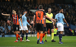 Shakhtar Donetsk players protest after Manchester City's Raheem Sterling (right) is awarded a penalty kick