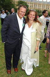 P Y GERBEAU and LADY FALCONER OF THOROTON at the annual House of Lords v House of Commons tug of war match in aid of  of  Macmillan Cancer Relief on 21st June 2005.  A drinks reception was held in College Gardens followd by the tug of war on Victoria Tower Gardens, London.                                 <br /><br />NON EXCLUSIVE - WORLD RIGHTS