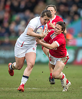 England Women's Katy Daley-Mclean evades the tackle of Wales Women's Kayleigh Powell<br /> <br /> Photographer Bob Bradford/CameraSport<br /> <br /> 2020 Women's Six Nations Championship - England v Wales - Saturday 7th March 2020 - The Stoop - London<br /> <br /> World Copyright © 2020 CameraSport. All rights reserved. 43 Linden Ave. Countesthorpe. Leicester. England. LE8 5PG - Tel: +44 (0) 116 277 4147 - admin@camerasport.com - www.camerasport.com