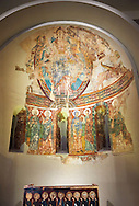 Apse of Saint Peter de la Seu d'Urgell<br /> <br /> Second quarter of the twelfth century<br /> Fresco transferred to canvas<br /> From the church of St. Peter currently dedicated to St. Michael and St. Peter Cathedral group of Seu d'Urgell (Alt Urgell)<br /> <br /> Acquisition of the Museum Board Campaign 1919-1923<br /> MNAC 15867<br /> <br /> <br /> The apse is the most important part of the church as it was where the altar was located. The apse of La Seu d'Urgell like most Romanesque apses was decorated with frescoes of a Theophany (referring to images of the Incarnation of Jesus).High up in the semi circular cupola of the apse is a large image of Christ in Majesty, or Christ Pantocrator, in a mandorla, a pointed verticle oval shaped aureola which surrounds the figures of Christ and the Virgin Mary in traditional Christian art.  This is flanked by Tetramorph showing the four evangelical symbols - St Matthew the man, St Mark the lion, St Luke the ox, and John the eagle. In the middle register is are a series of  frescoes of the Apostles and the figure of Mary. The lower register, which has not been preserved, must have been painted curtains that imitated luxury fabrics. .<br /> <br /> If you prefer you can also buy from our ALAMY PHOTO LIBRARY  Collection visit : https://www.alamy.com/portfolio/paul-williams-funkystock/romanesque-art-antiquities.html<br /> Type -     MNAC     - into the LOWER SEARCH WITHIN GALLERY box. Refine search by adding background colour, place, subject etc<br /> <br /> Visit our ROMANESQUE ART PHOTO COLLECTION for more   photos  to download or buy as prints https://funkystock.photoshelter.com/gallery-collection/Medieval-Romanesque-Art-Antiquities-Historic-Sites-Pictures-Images-of/C0000uYGQT94tY_Y
