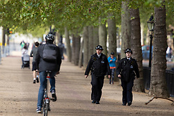 © Licensed to London News Pictures. 11/05/2021. London, UK. Police patrol the Mall ahead of the state opening of Parliament . Photo credit: George Cracknell Wright/LNP