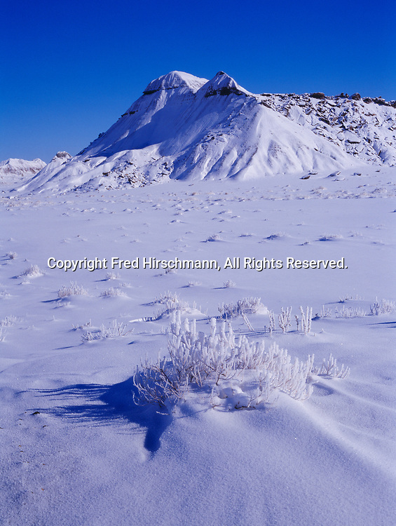 The Teepees shrouded in winter snow, Petrified Forest National Park, Arizona.
