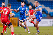 Halifax RLFC interchange Brandon Moore (14) kicks through during the Betfred Championship match between Halifax RLFC and London Broncos at the MBi Shay Stadium, Halifax, United Kingdom on 8 April 2018. Picture by Simon Davies.