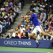 Novak Djokovic, Serbia, in action against Roger Federer, Switzerland, in the Men's Singles Final during the US Open Tennis Tournament, Flushing, New York, USA. 13th September 2015. Photo Tim Clayton