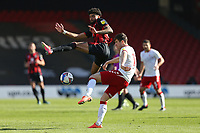 Football - 2020 / 2021 Sky Bet Championship - AFC Bournemouth vs. Middlesbrough - The Vitality Stadium<br /> <br /> Bournemouth's Philip Billing tries to charge down a clearance from Paddy McNair of Middlesbrough during the Championship match at the Vitality Stadium (Dean Court) Bournemouth  <br /> <br /> COLORSPORT/SHAUN BOGGUST