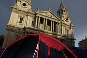 Red dome tent below Wren architecture on the 11th day of the Occupy London protest camp in St Paul's cathedral churchyard, London 26/11/11. City lawyers are using medieval pedestrian bylaws to gain a court injunction to evict the activists who set up tents and shelters as in other countries.