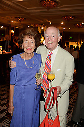 PAT NIMMO widow of actor Derek Nimmo and playwright and actor RAY COONEY at the 90th birthday party for Nicholas Parsons held at the Hyatt Churchill Hotel, Portman Square, London on 8th October 2013.