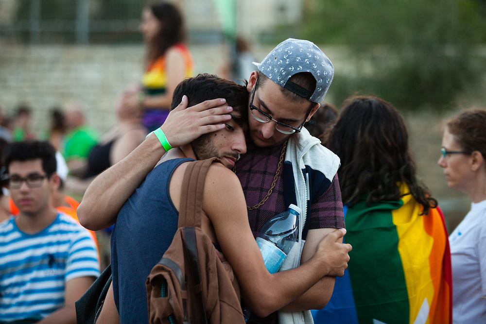 People react after an ultra-Orthodox Jewish extremist stabbed and injured six people, during a Gay Pride parade in Jerusalem, Israel on July 30, 2015. The assailant, an ultra-Orthodox Jewish man identified as Yishai Shlissel, emerged behind the marchers and began stabbing them while screaming. He was arrested by the Israeli police. Shlissel was recently released from prison after serving a term for stabbing several people at a gay pride parade in 2005.