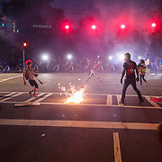 CHARLOTTE, NC - June 2: CMPD officers deploy a stun grenade after a confrontation with protestors near uptown Charlotte, NC on June 2, 2020. The days long protest in cities around the world was sparked by the police killing of George Floyd by Minneapolis PD officer,  Derek Chauvin while 3 officers watched.  (Photo by Logan Cyrus for AFP)