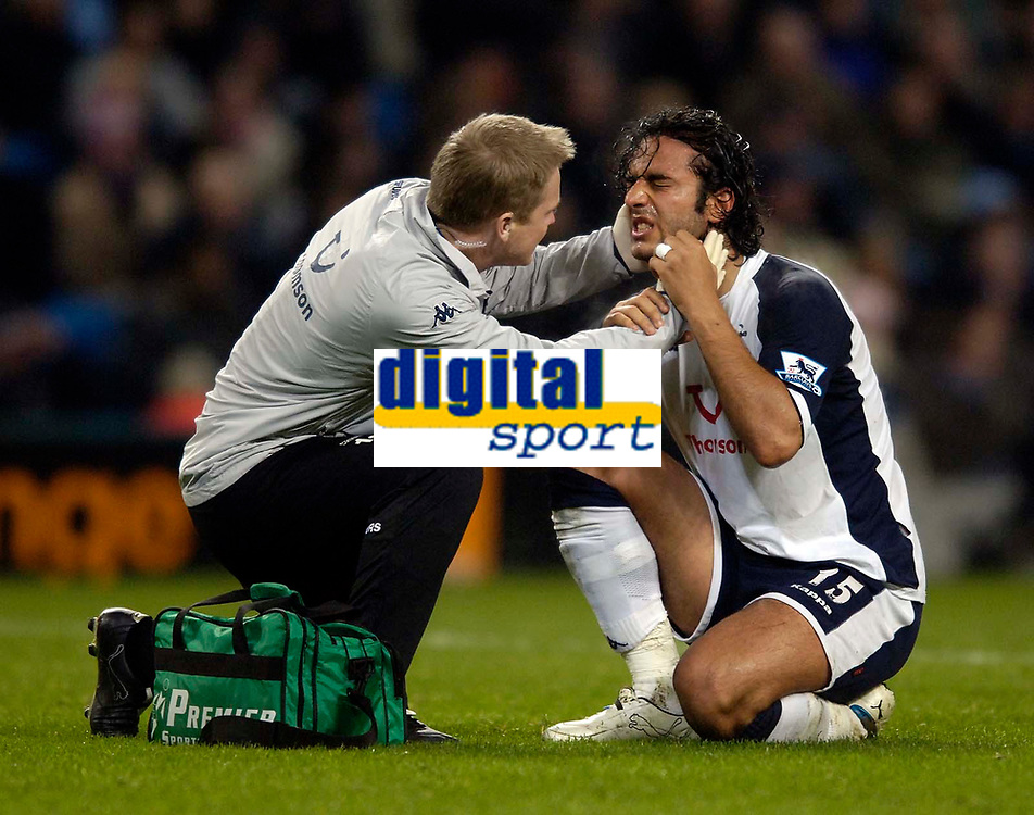 Photo: Jed Wee.<br /> Manchester City v Tottenham Hotspur. The Barclays Premiership. 04/01/2006.<br /> <br /> Tottenham's Mido receives treatment for a knock to his temple.